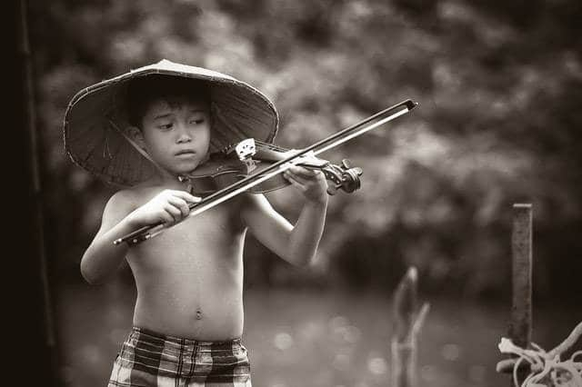a child playing violin